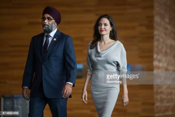 Harjit Sajjan Canada's defense minister left walks with actress Angelina Jolie special envoy to the United Nations High Commissioner for Refugees...