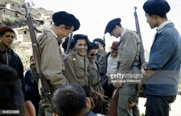 Harkis joking with a group of children in Tizi Ouzou Kabylie Algeria in 1959 during the Algerian war
