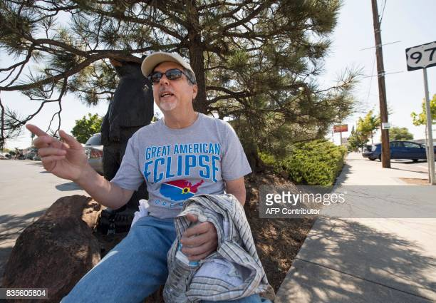 Harland Sanders of Fayetteville North Carolina waits outside a diner for friends on August 19 2017 in Madras Oregon The town is preparing for the...