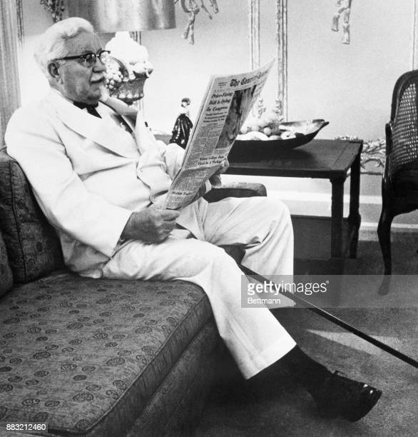 Harland Sanders relaxing at home reading the newspaper
