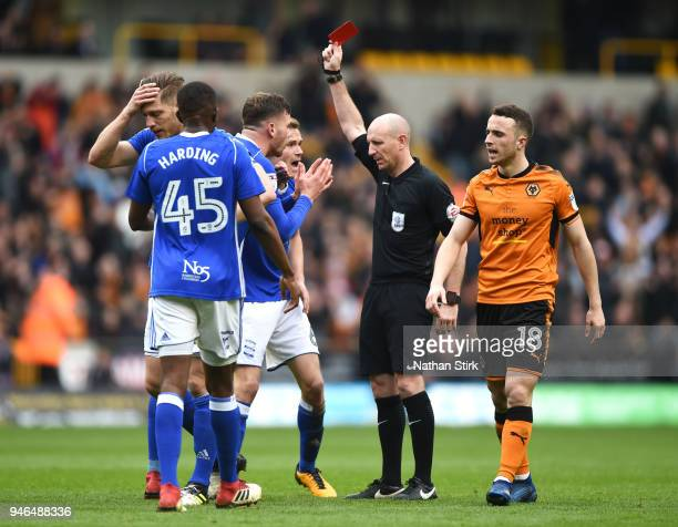 Harlee Dean of Birmingham City is shown a red card by referee Andie Davies during the Sky Bet Championship match between Wolverhampton Wanderers and...