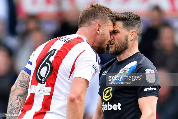 Harlee Dean of Brentford and Craig Conway of Blackburn Rovers confront each other during the Sky Bet Championship match between Brentford and...