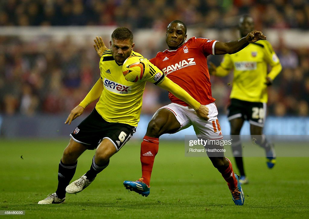Harlee Dean of Brentford battles with Michail Antonio of Forest during the Sky Bet Championship match between Nottingham Forest and Brentford at the City Ground on November 5, 2014 in Nottingham, England.