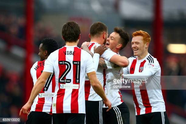 Harlee Dean of Brentford celebrates with teammates after scoring his side's second goal during the Sky Bet Championship match between Brentford and...
