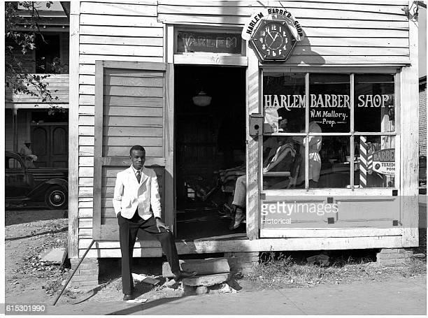 Harlem Barber Shop, located on Main Street. Oxford, North Carolina, November 1939. | Location: Oxford, North Carolina, USA.
