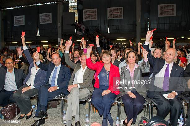 Harlem Desir Francois Hollande Bertrand Delanoe Martine Aubry Segolene Royal and Laurent Fabius vote with the audience at the French Socialist Party...