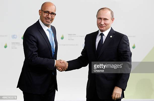 Harlem Desir, French Minister of State for European affairs welcomes Russian President Vladimir Putin as he arrives for the COP21 United Nations...