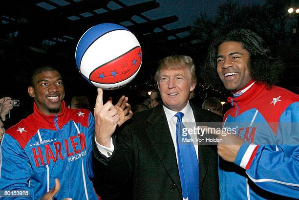 Harlem Globetrotter Buckets and WildKat show benefit donor Donald Trump how to spin a basketball on his finger at the 2008 Skating with the Stars...