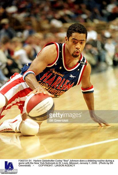 Harlem Globetrotter Curley 'Boo' Johnson does a dribbling routine during a game with the New York Nationals in St Louis Missouri January 7 2000