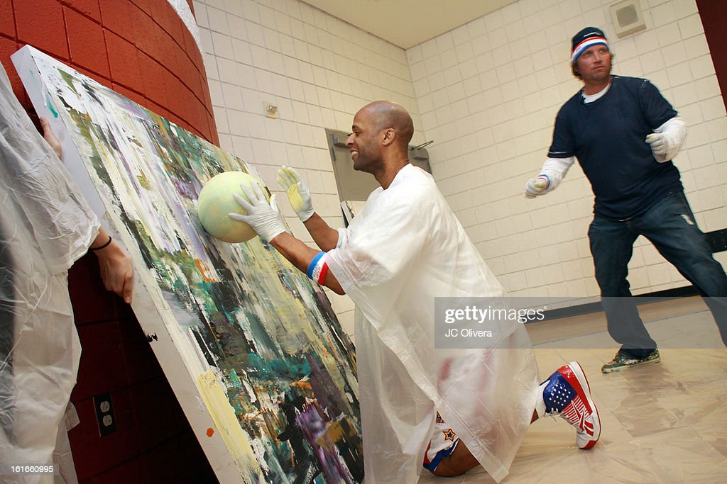 Harlem Globetrotter Herb Lang (L) and Pop Surrealist Artist Daniel Maltzman during the unveiling of 'The Art & Soul Of Basketball' at Pan Pacific Recreation Complex on February 13, 2013 in Los Angeles, California.
