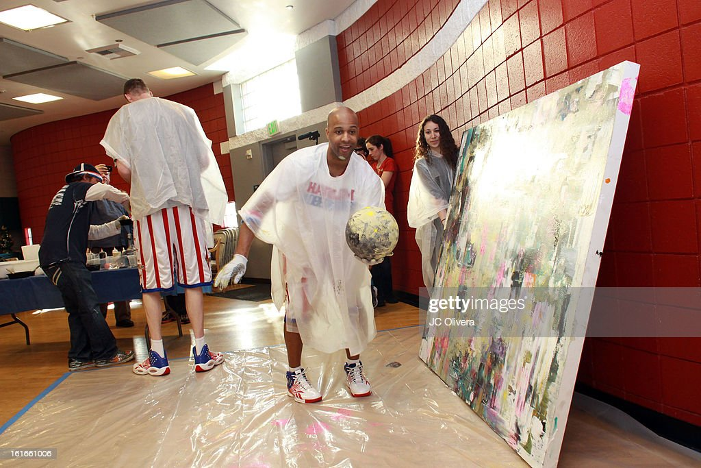 Harlem Globetrotter Herb Lang (R) during the unveiling of 'The Art & Soul Of Basketball' at Pan Pacific Recreation Complex on February 13, 2013 in Los Angeles, California.