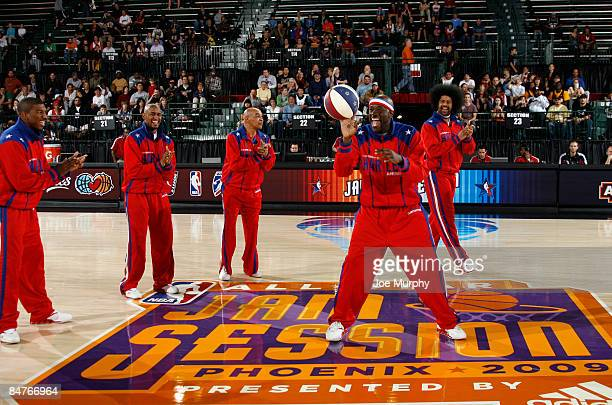 Harlem Globetrotter members Curly Neal Handles Franklin Wildkat Edgerson Buckets Blakes Special K Daley and Scooter Christensen perform for the fans...