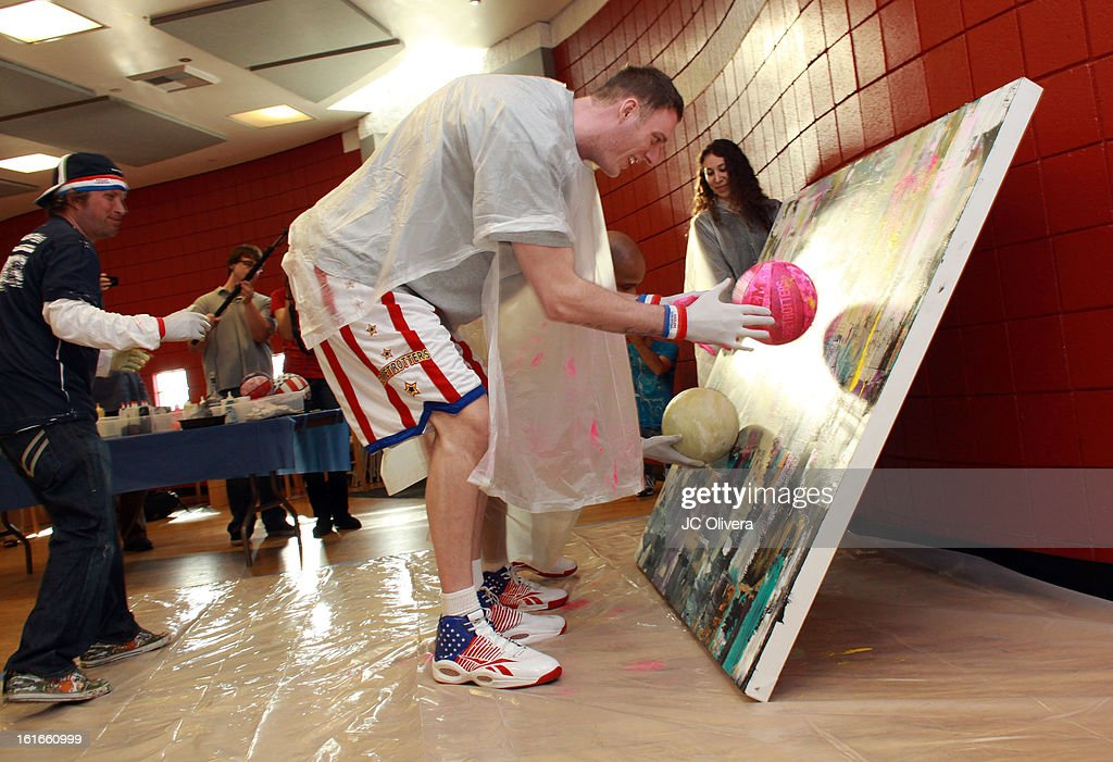 Harlem Globetrotter Paul Sturgess (R) and Pop Surrealist Artist Daniel Maltzman (L) during the unveiling of 'The Art & Soul Of Basketball' at Pan Pacific Recreation Complex on February 13, 2013 in Los Angeles, California.