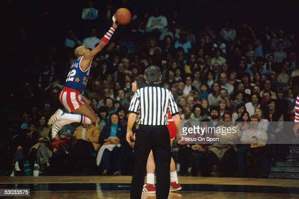 Harlem Globetrotters' Curly Neal makes a jumpshot during a game