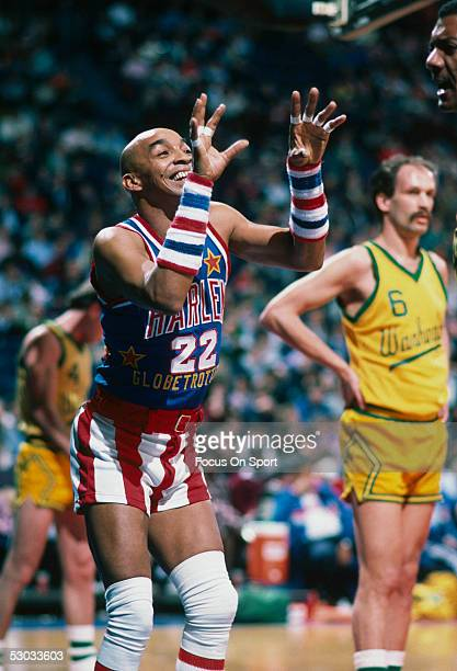 Harlem Globetrotters' Curly Neal makes a show during a game