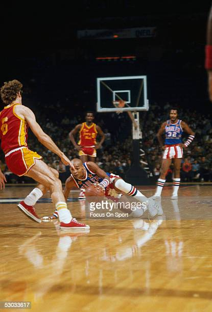 Harlem Globetrotters' Curly Neal uses his fancy dribbling techniques on the court during a game
