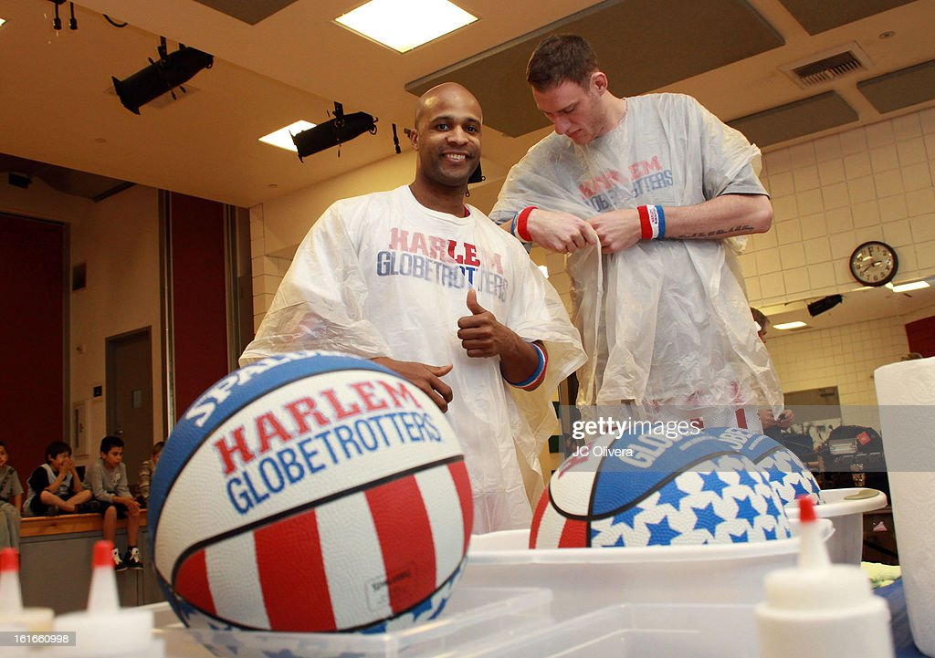 Harlem Globetrotters Herb Lang (L) and Paul Sturgess during the unveiling of 'The Art & Soul Of Basketball' at Pan Pacific Recreation Complex on February 13, 2013 in Los Angeles, California.