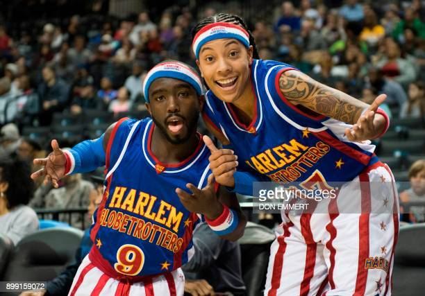 Harlem Globetrotter's Hot Shot Swanson and Bria Annei Young known as 'Swish' pose for a photo at the Barclays Center December 26 2017 in New York...