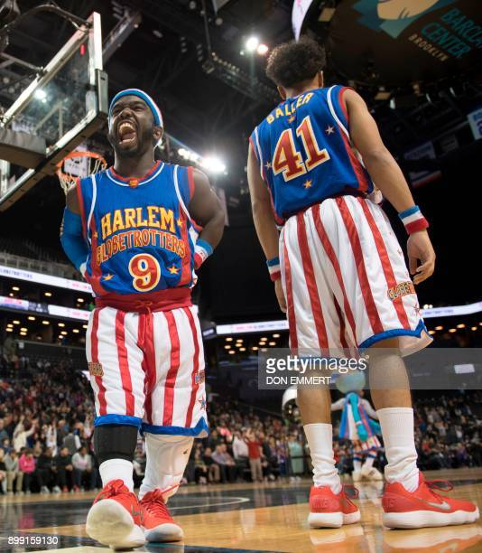 Harlem Globetrotter's Hot Shot Swanson celebrates while playing against the Washington Generals at the Barclays Center December 26 2017 in New York...