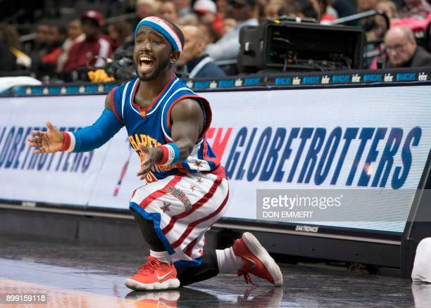 Harlem Globetrotter's Hot Shot Swanson cheers for his teammates during their game against the Washington Generals at the Barclays Center December 26...