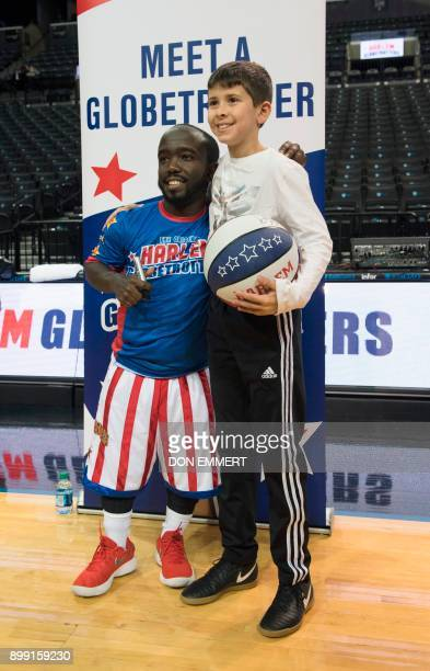 Harlem Globetrotter's Hot Shot Swanson poses for a photo while signing autographs at the Barclays Center December 26 2017 in New York Known as the...