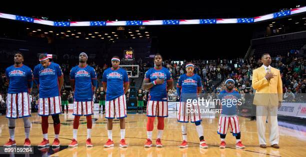 Harlem Globetrotter's Hot Shot Swanson stands for the national anthem with his coach and teammates at the Barclays Center December 26 2017 in New...