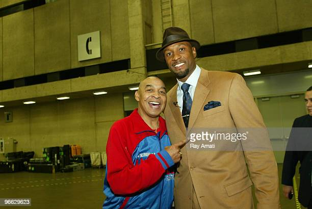Harlem Globetrotters Legend Curly Neal poses with NBA Legend Alonzo Mourning prior to the 2010 NBA AllStar Celebrity Game presented by FINAL FANTASY...