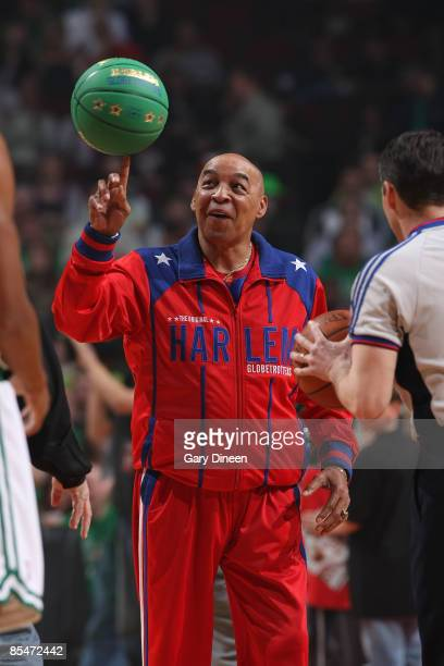 Harlem Globetrotter's Legend Curly Neal spins a basketball on his finger prior to the NBA game between the Boston Celtics and the Chicago Bulls on...