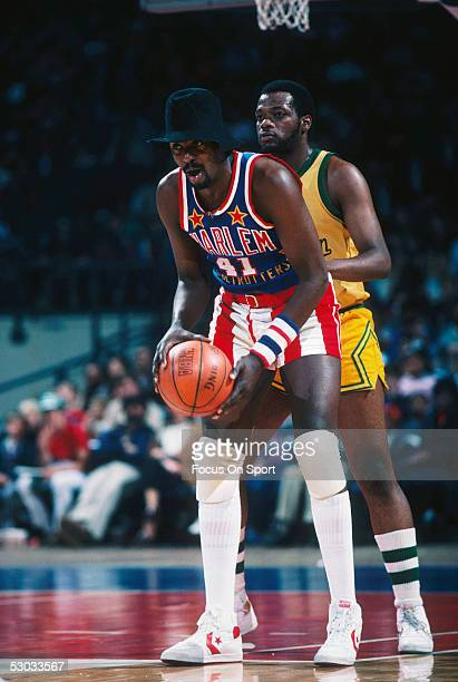 Harlem Globetrotters' Lou Dunbar messes around with the competition during a game