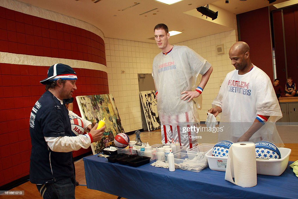 Harlem Globetrotters Paul Sturgess (C), Herb Lang (R) and Pop Surrealist Artist Daniel Maltzman (L) during the unveiling of 'The Art & Soul Of Basketball' at Pan Pacific Recreation Complex on February 13, 2013 in Los Angeles, California.