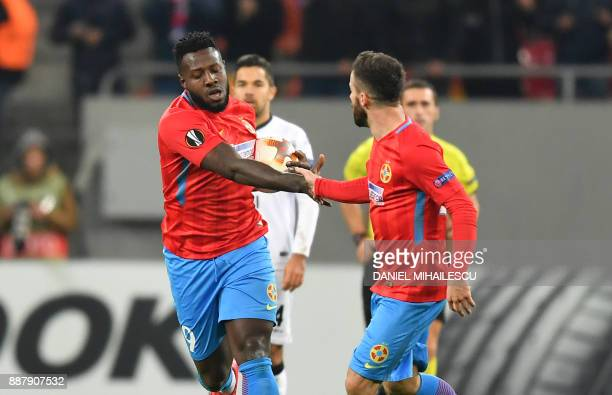Harlem Gnohere of Steaua Bucharest celebrates with his teammate Gabriel Enache after he scored the 12 against of Energy Investment Lugano during the...