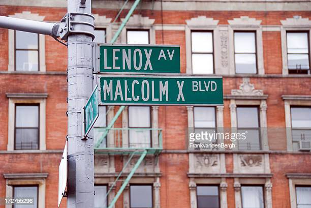 harlem malcolm x blvd street sign - harlem stock pictures, royalty-free photos & images