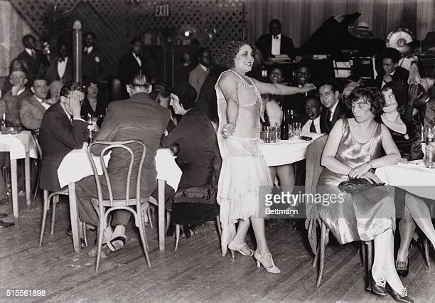 Picture shows 'The Entertainer' at Small's Paradise Club in Harlem A woman is shown dancing while men and women seated at tables watch