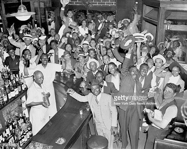 Harlem residents at a bar on 135th St raise a jubilant toast after world heavyweight champion Joe Louis' firstround knockout of Max Schmeling in...