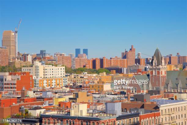 harlem rooftops, nyc - east harlem - fotografias e filmes do acervo