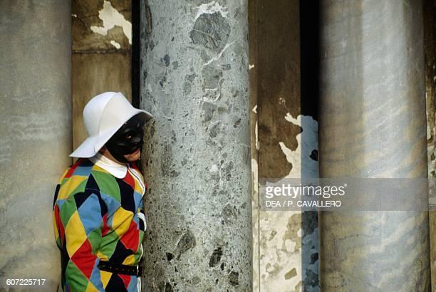 Harlequin costume at Venice carnival Veneto Italy