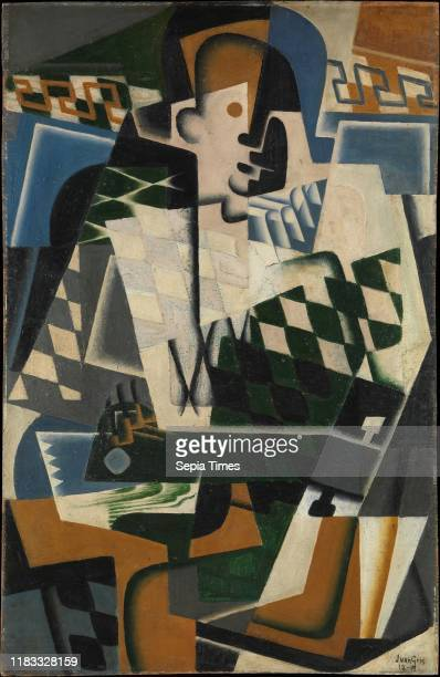Harlequin with a Guitar Oil on panel 39 1/2 Ñ 25 5/8 inches Paintings Juan Gris Like many European artists before them Cubists often depicted...