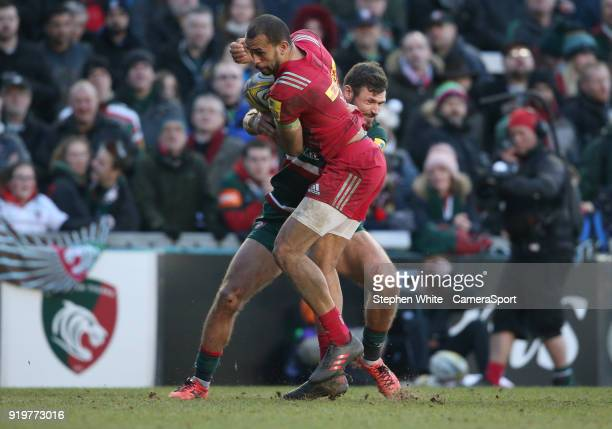 Harlequins' Aaron Morris is tackled by Leicester Tigers' Adam Thompstone during the Aviva Premiership match between Leicester Tigers and Harlequins...