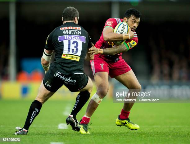 Harlequins' Alofa Alofa evades the tackle of Exeter Chiefs' Ian Whitten during the Aviva Premiership match between Exeter Chiefs and Harlequins at...