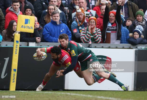 Harlequins' Alofa Alofa scores his side's first try despite the attentions of Leicester Tigers' Jonah Holmes during the Aviva Premiership match...