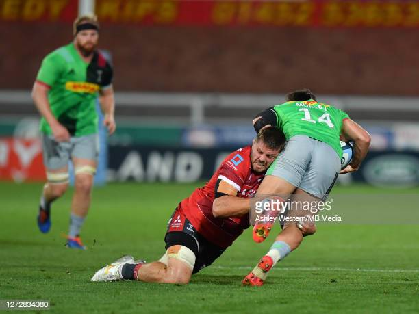 Harlequins' Cadan Murley is tackled by Gloucester Rugby's Ed Slater during the Gallagher Premiership Rugby match between Gloucester Rugby and...