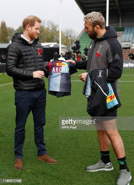 Harlequins Captain Chris Robshaw gives Prince Harry, Duke of Sussex a small rugby shirt for baby Archie during a Terrence Higgins Trust event ahead...