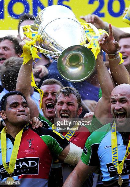 Harlequins captain Chris Robshaw lifts the trophy following his team's victory during the Aviva Premiership final between Harlequins and Leicester...