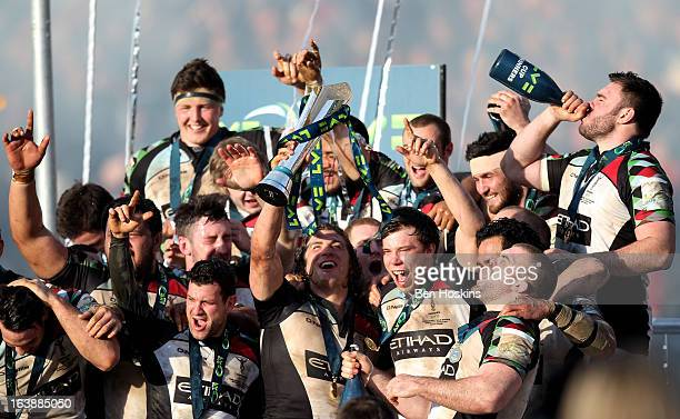 Harlequins captain Luke Wallace lifts the trophy following his team's victory during the LV= Cup Final between Sale Sharks and Harlequins at Sixways...