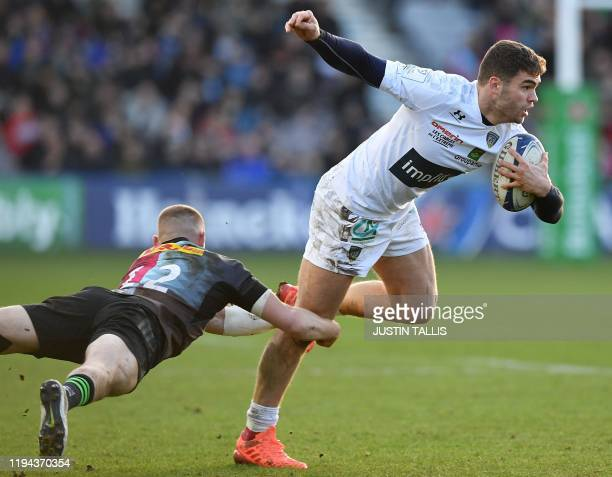 Harlequins' centre Tom Penny tackles Clermont's French wing Damian Penaud during the European Rugby Champions Cup first round pool 3 rugby union...