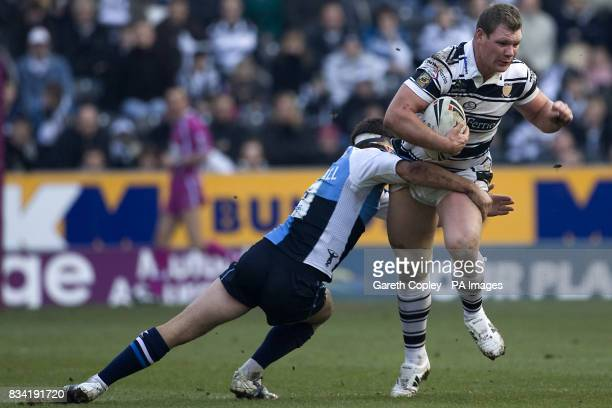 Harlequins' Chad Randall tackles Hull FC's Danny Tickle