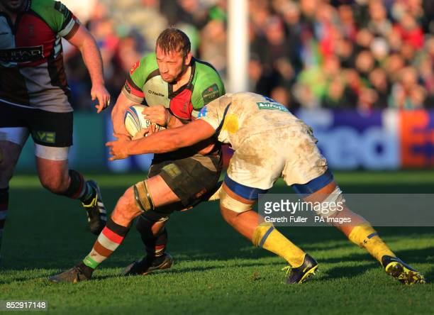 Harlequins Chris Robshaw is challenged by Clermont's Damien Chouly during the Heineken Cup Pool Four match at Twickenham Stoop London