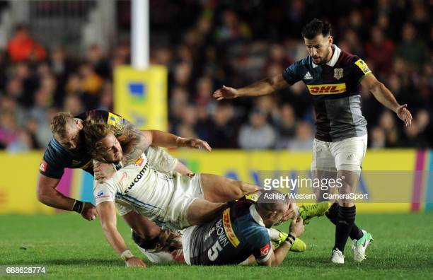 Harlequins' Danny Care waits for the ball from Mike Brown as Joe Marler takes out Michele Campagnaro during the Aviva Premiership match between...