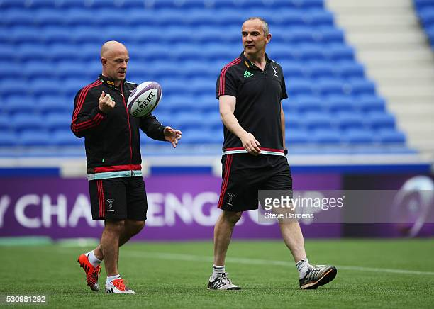 Harlequins Director of Rugby Conor O'Shea and coach Mark Mapletoft walk on the pitch during the Harlequins Captain's Run on the eve of the European...