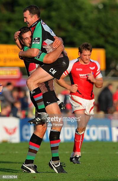 Harlequins fly half Chris Malone celebrates on the final whistle with Nick Easter after their victory during the Heineken Cup Round One match between...